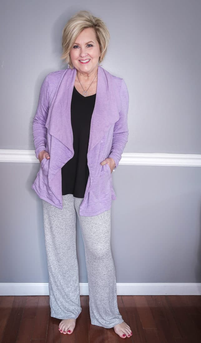 Fashion Blogger 50 Is Not Old is wearing a lilac cardigan and a gray loungewear pant