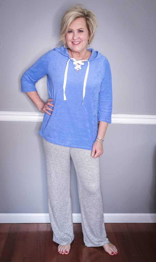 Fashion Blogger 50 Is Not Old is wearing a blue terry lace up hoodie and gray loungewear pants