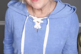 Fashion Blogger 50 Is Not Old is wearing a blue terry lace up hoodie
