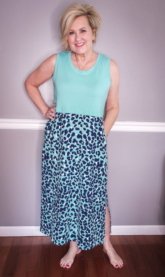 Fashion Blogger 50 Is Not Old is wearing a lagoon/animal print maxi dress