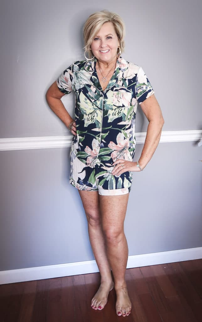 Fashion Blogger 50 Is Not Old wearing a floral button up pajama set