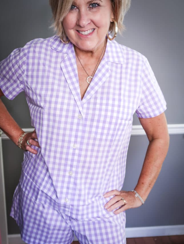Fashion Blogger 50 Is Not Old wearing a gingham button up pajama set