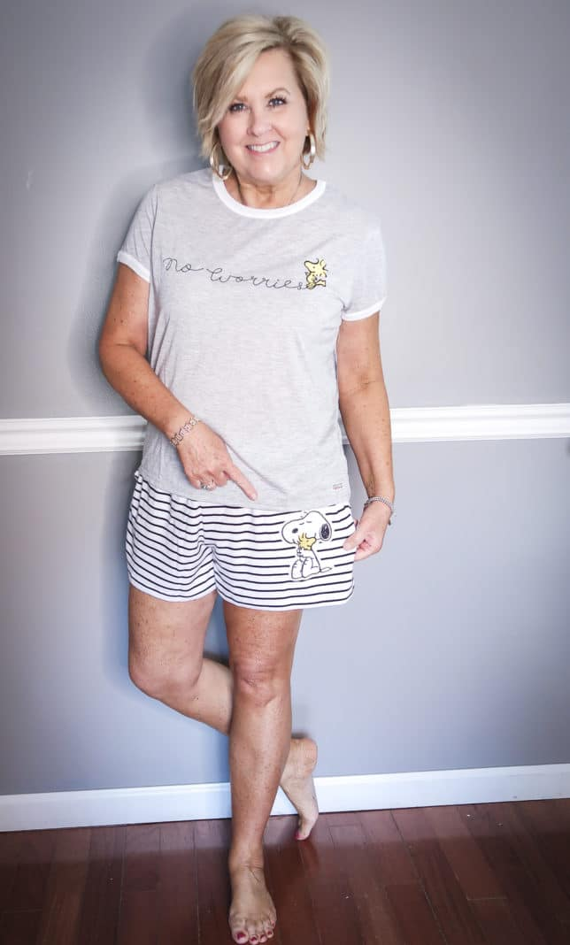 Fashion Blogger 50 Is Not Old wearing a no worries pajama set with striped shorts with Peanuts characters