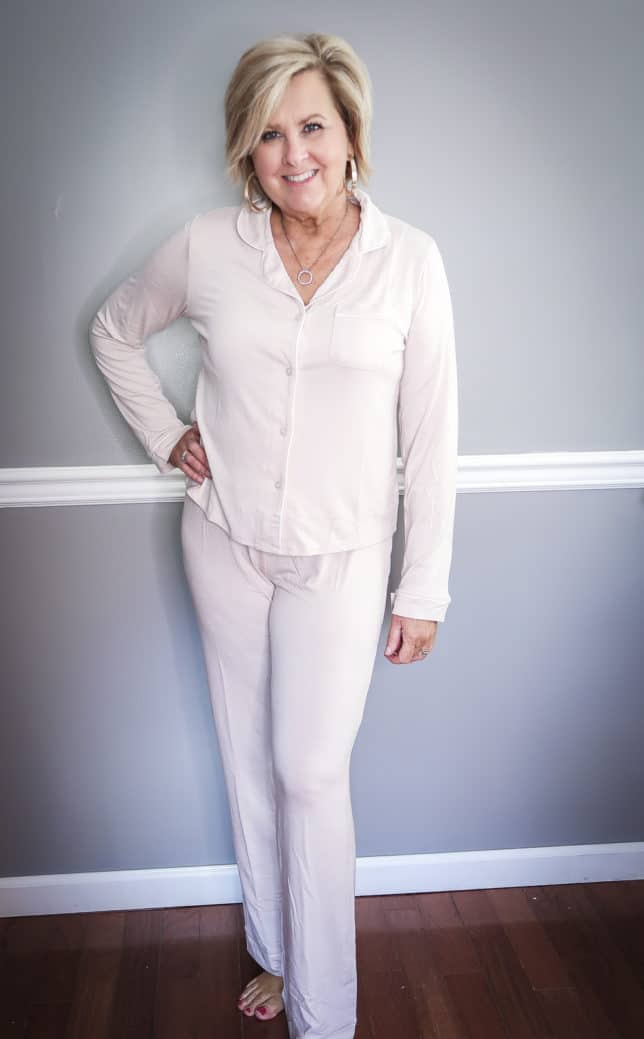 Fashion Blogger 50 Is Not Old wearing a pale pink pajama set with long pants and sleeves