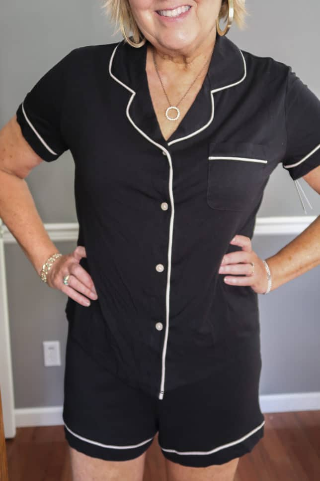 Fashion Blogger 50 Is Not Old wearing a short black pajama set with white piping