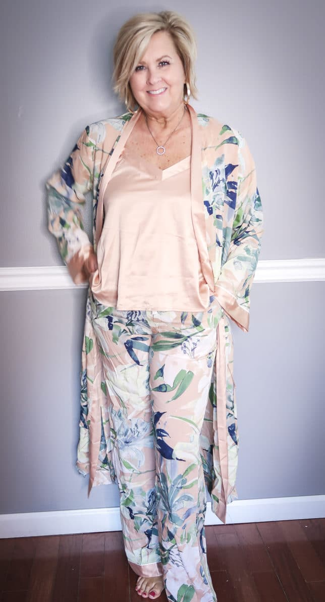 Fashion Blogger 50 Is Not Old wearing a floral robe with matching pants and a camisole
