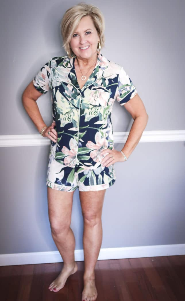 Fashion Blogger 50 Is Not Old wearing a short floral button up pajama set