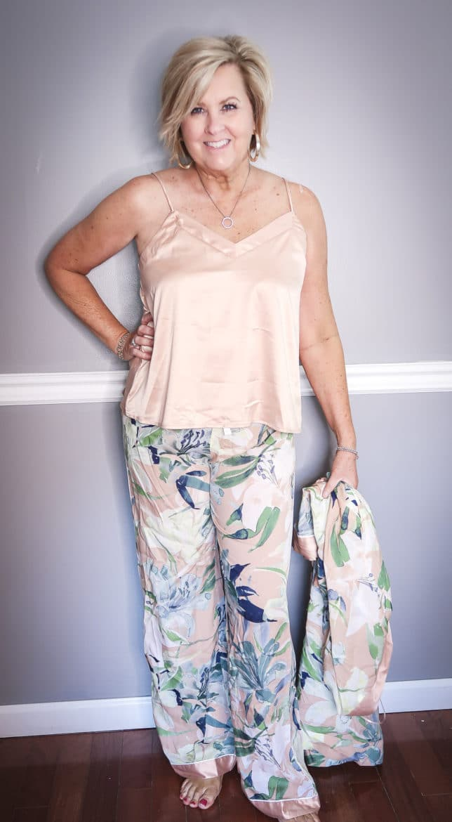 Fashion Blogger 50 Is Not Old wearing a floral pants and a camisole