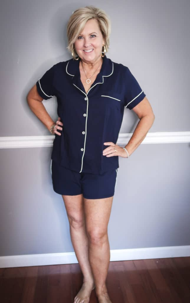 Fashion Blogger 50 Is Not Old wearing a navy button up pajama set