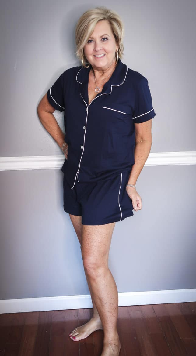Fashion Blogger 50 Is Not Old wearing a short navy button up pajama set