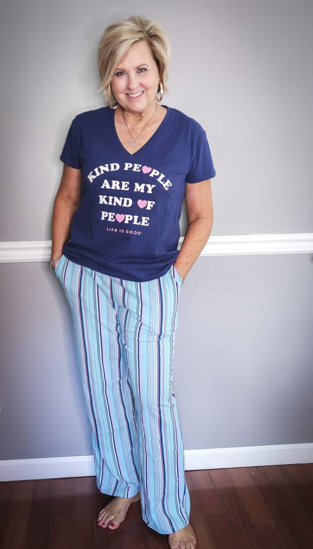 Fashion Blogger 50 Is Not Old wearing a navy and striped pants pajama set