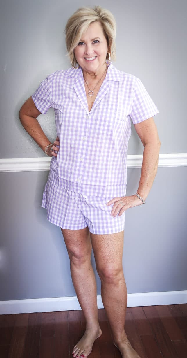 Fashion Blogger 50 Is Not Old wearing a lilac gingham pajama set