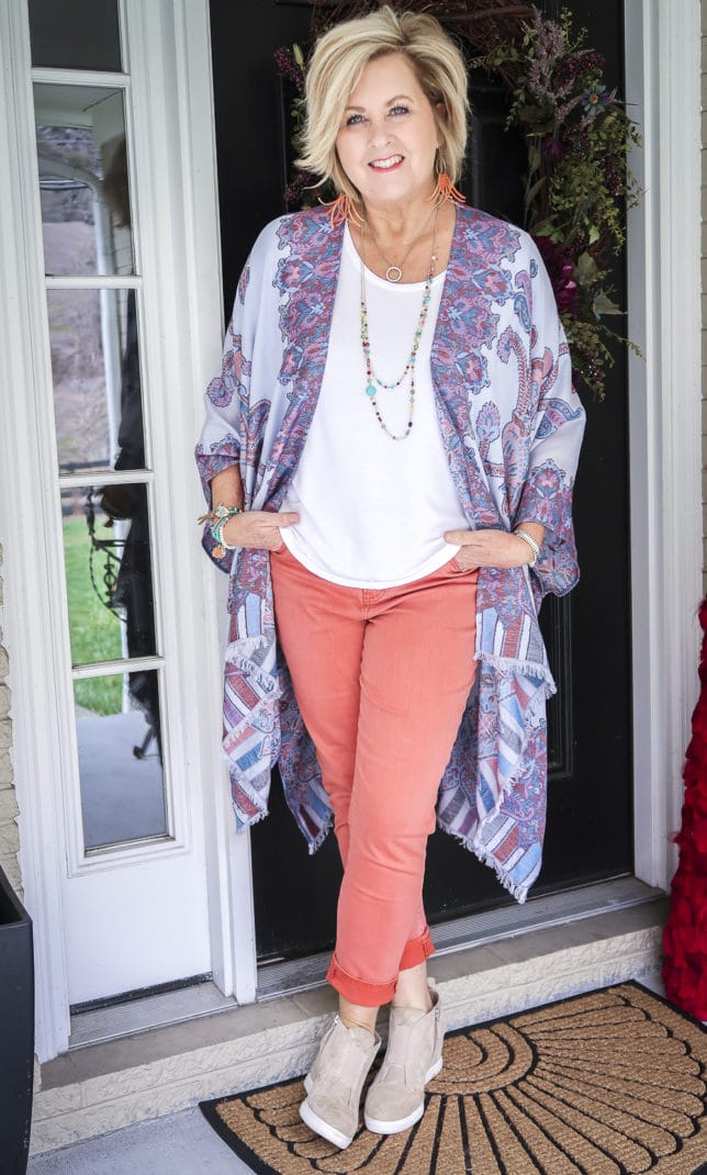 Fashion Blogger 50 Is Not Old wearing spring colors in a gorgeous Ruana, a white tee, and coral girlfriend jeans