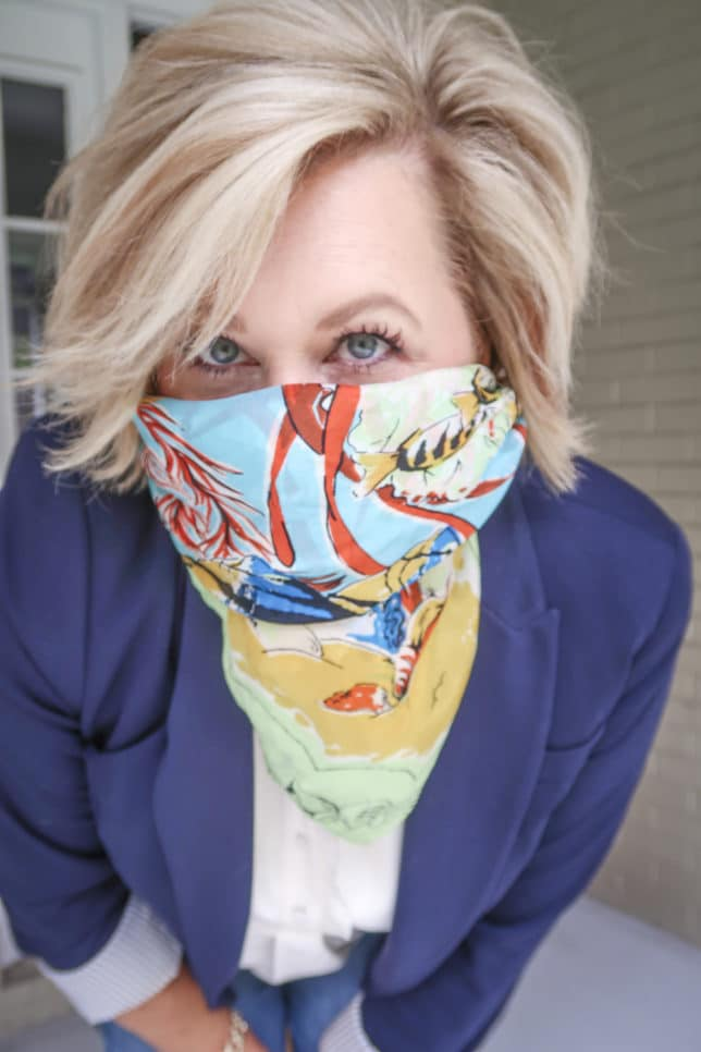 Fashion Blogger 50 Is Not Old is wearing a colorful scarf over her face