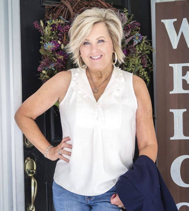 Fashion Blogger 50 Is Not Old is wearing a ruffled sleeveless blouse