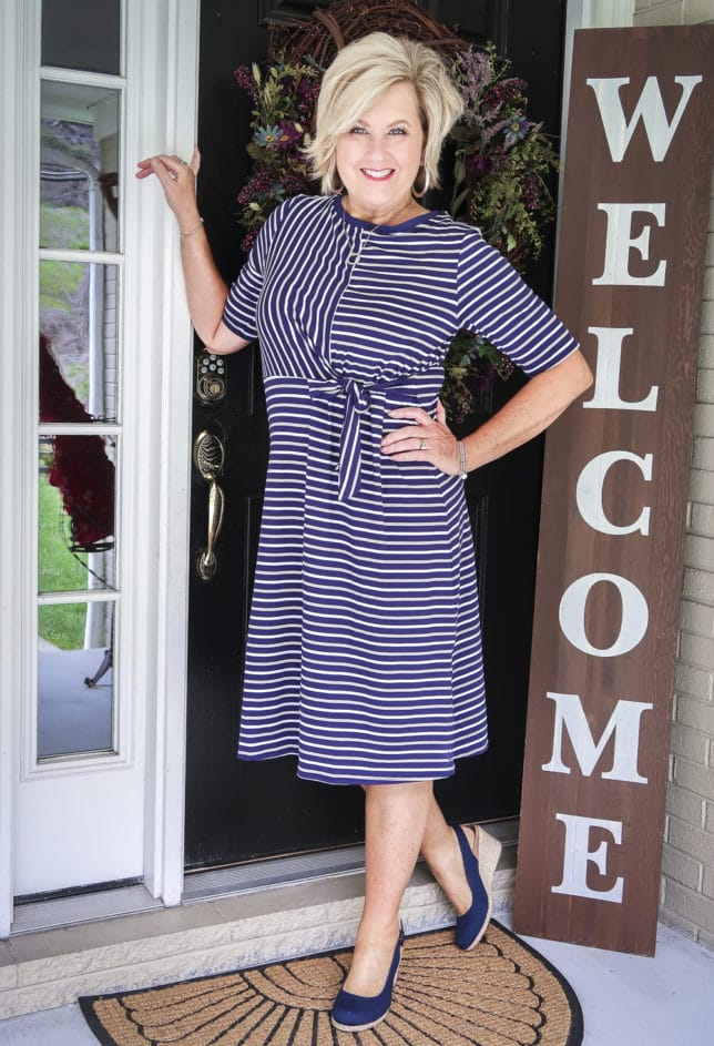 50 Is not Old is wearing a striped faux wrap dress with navy espadrilles