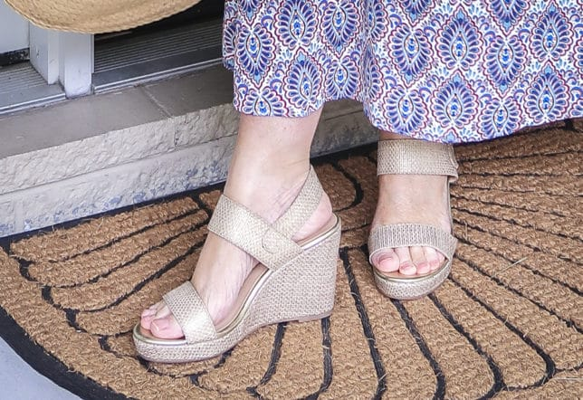 Fashion Blogger 50 Is Not Old wearing a gorgeous v-neck printed dress from Scoop, and metallic gold espadrille sandals