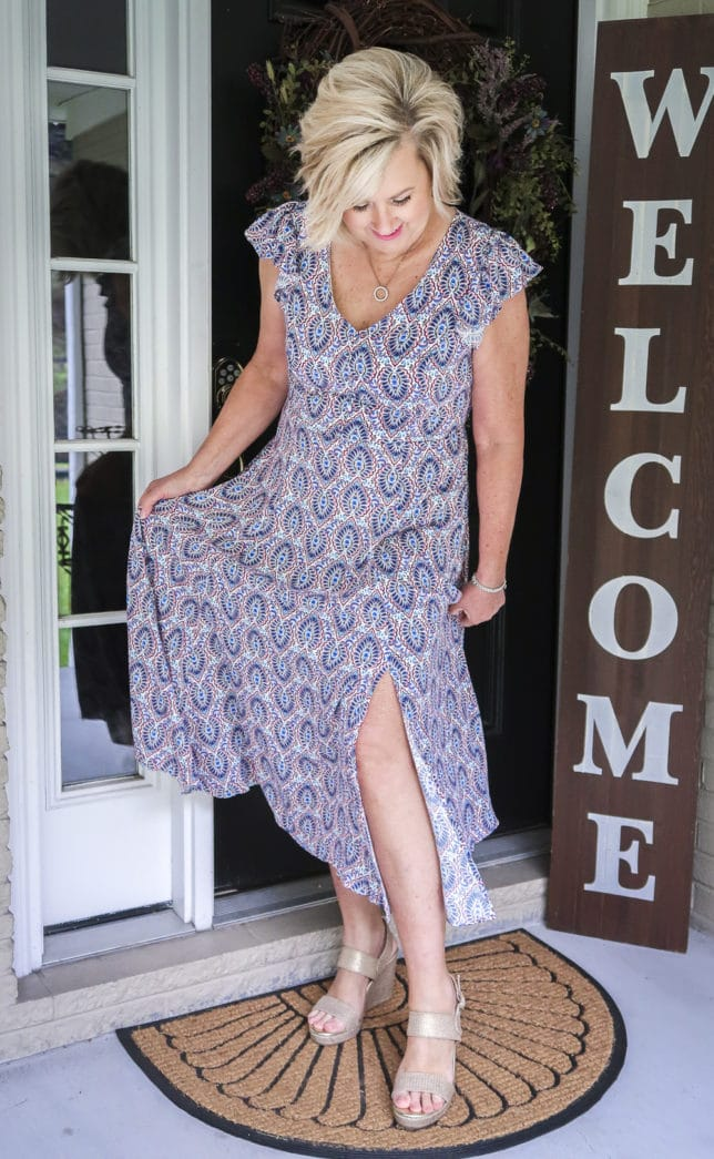 Fashion Blogger 50 Is Not Old wearing a gorgeous v-neck printed dress with a deep side split from Scoop, and metallic gold espadrille sandals all available at Walmart