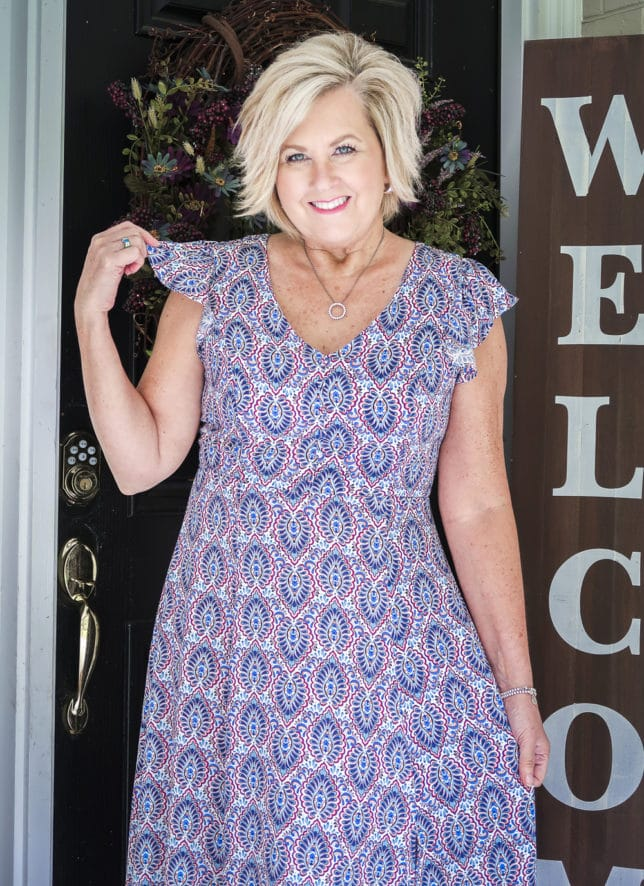 Fashion Blogger 50 Is Not Old wearing a gorgeous v-neck printed dress with flutter sleeves from Scoop, all available at Walmart