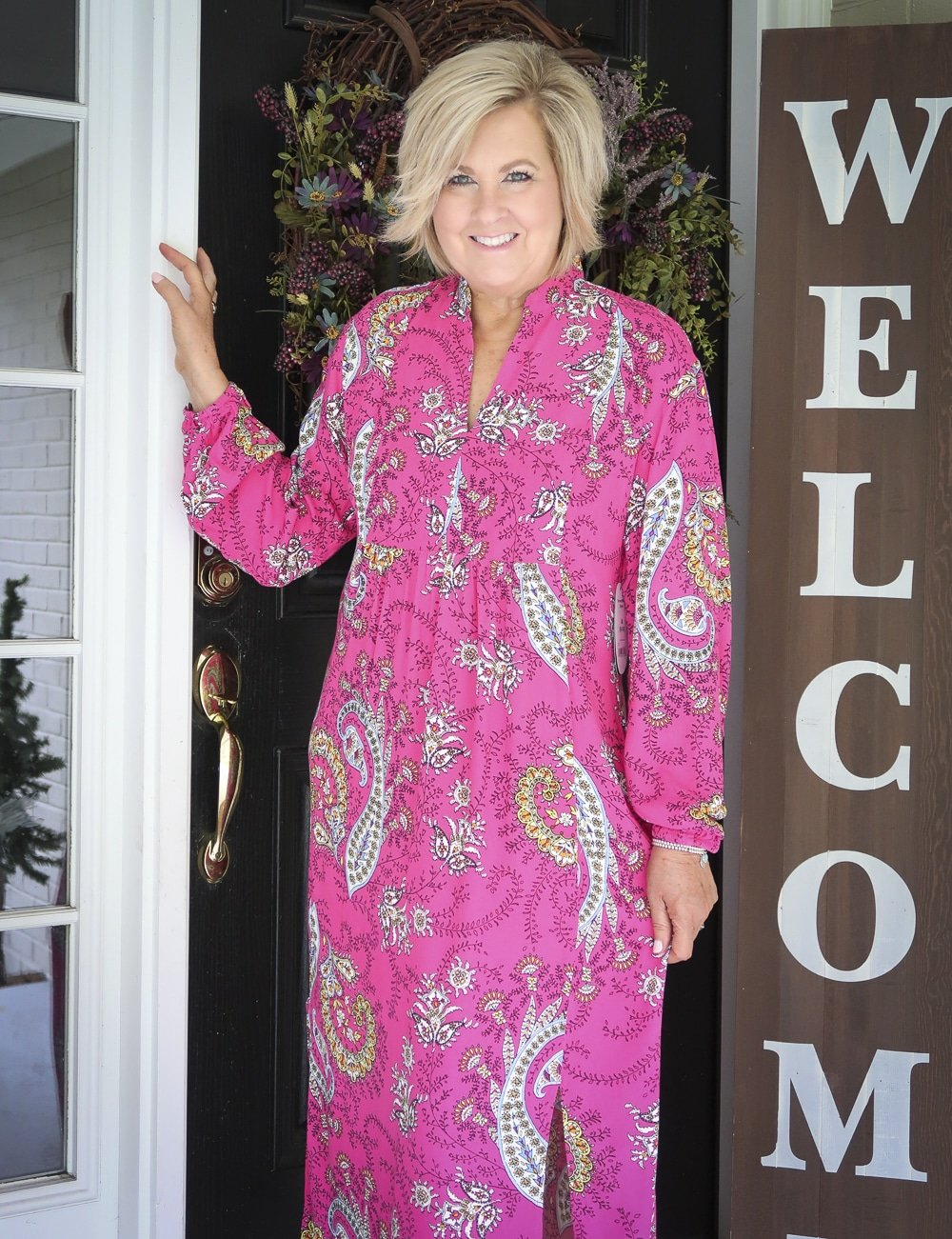Fashion Blogger 50 Is Not Old is wearing a bright pink paisley midi dress