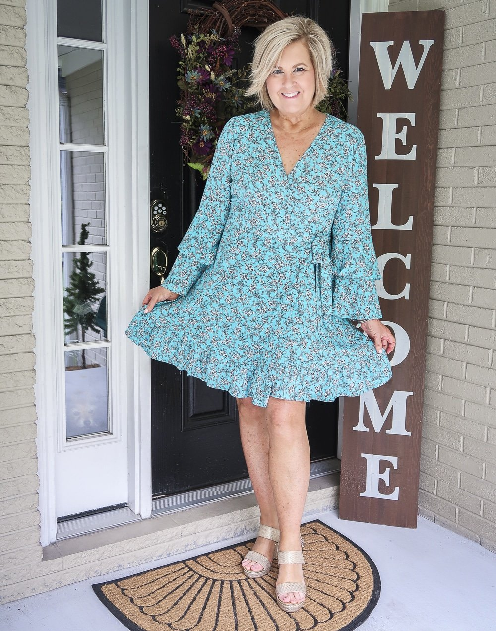 Fashion Blogger 50 Is Not Old is wearing a beautiful summer turquoise wrap dress from Walmart