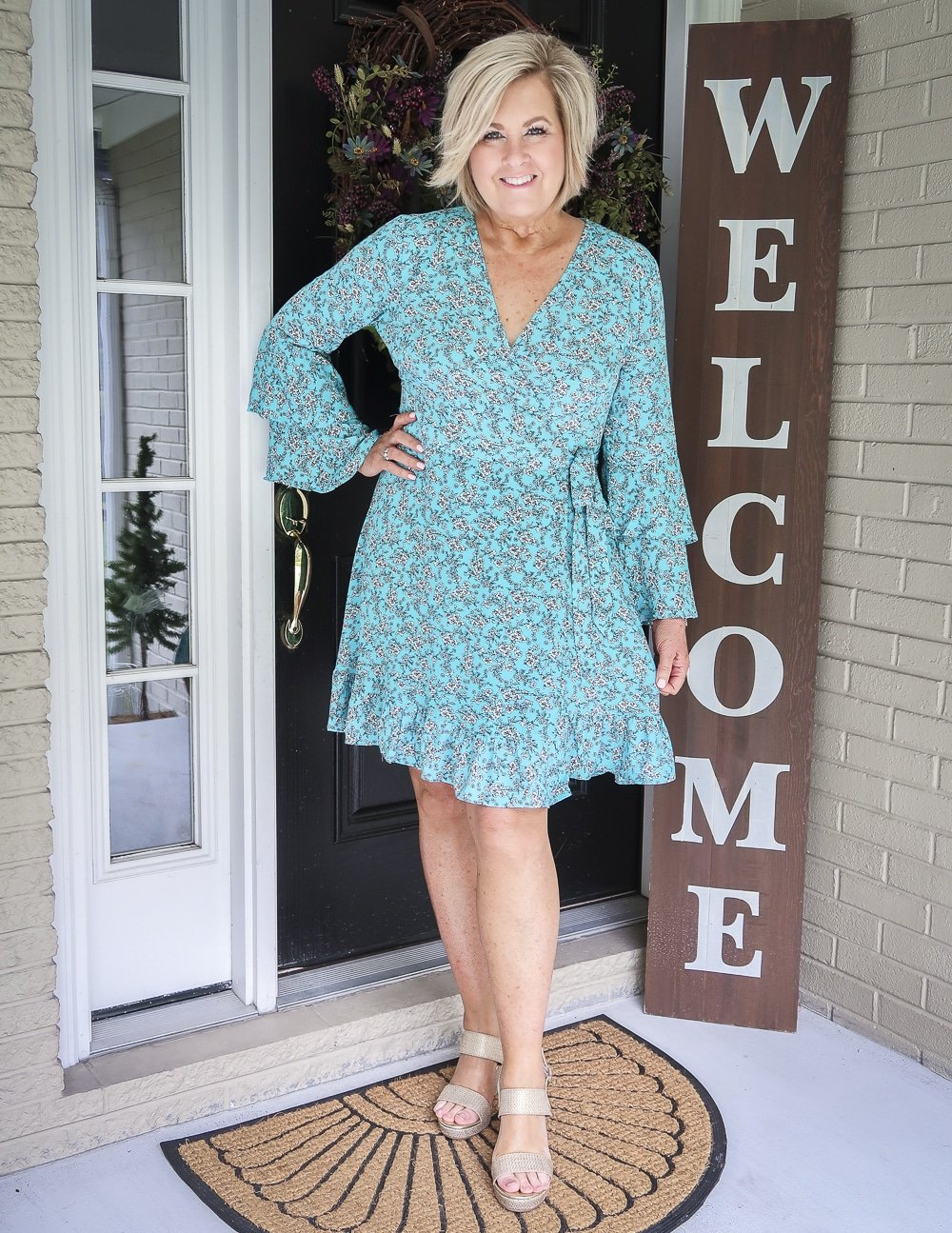 Fashion Blogger 50 Is Not Old is wearing a beautiful summer turquoise wrap dress and gold espadrille shoes from Walmart