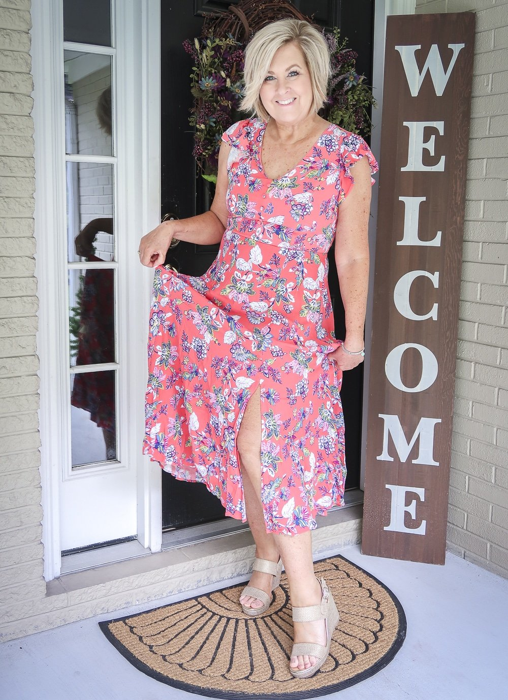 Fashion Blogger 50 Is Not Old is wearing a beautiful summer coral dress and gold espadrille shoes from Walmart