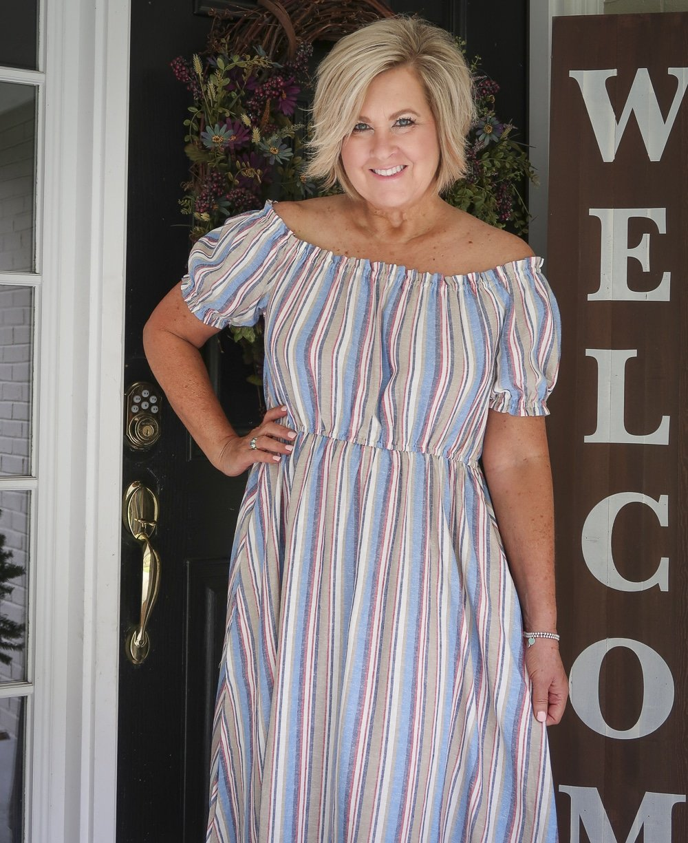 Fashion Blogger 50 Is Not Old is wearing a off the shoulder striped summer dress