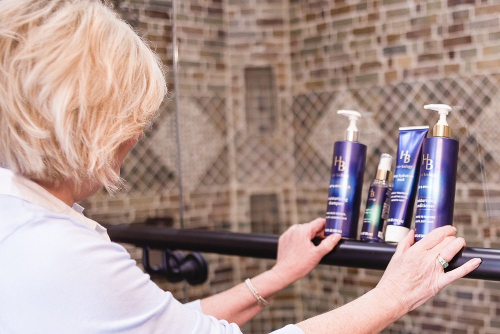 Fashion Blogger 50 Is Not Old looking at hair products by Hair Biology