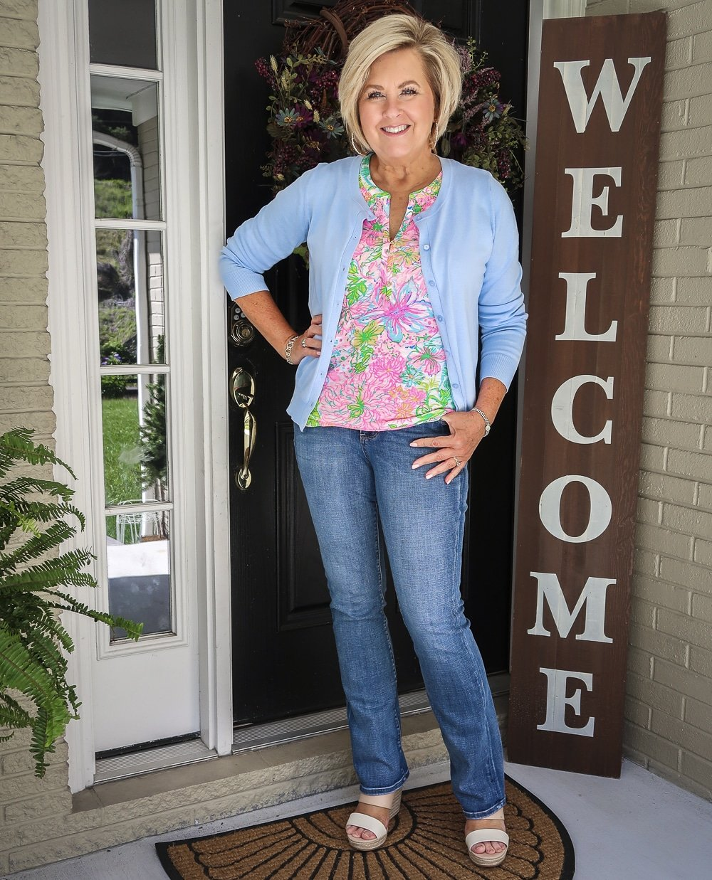 Fashion Blogger 50 Is Not Old is wearing a baby blue cardigan and a Lilly Pulitzer top with jeans and espadrille sandals