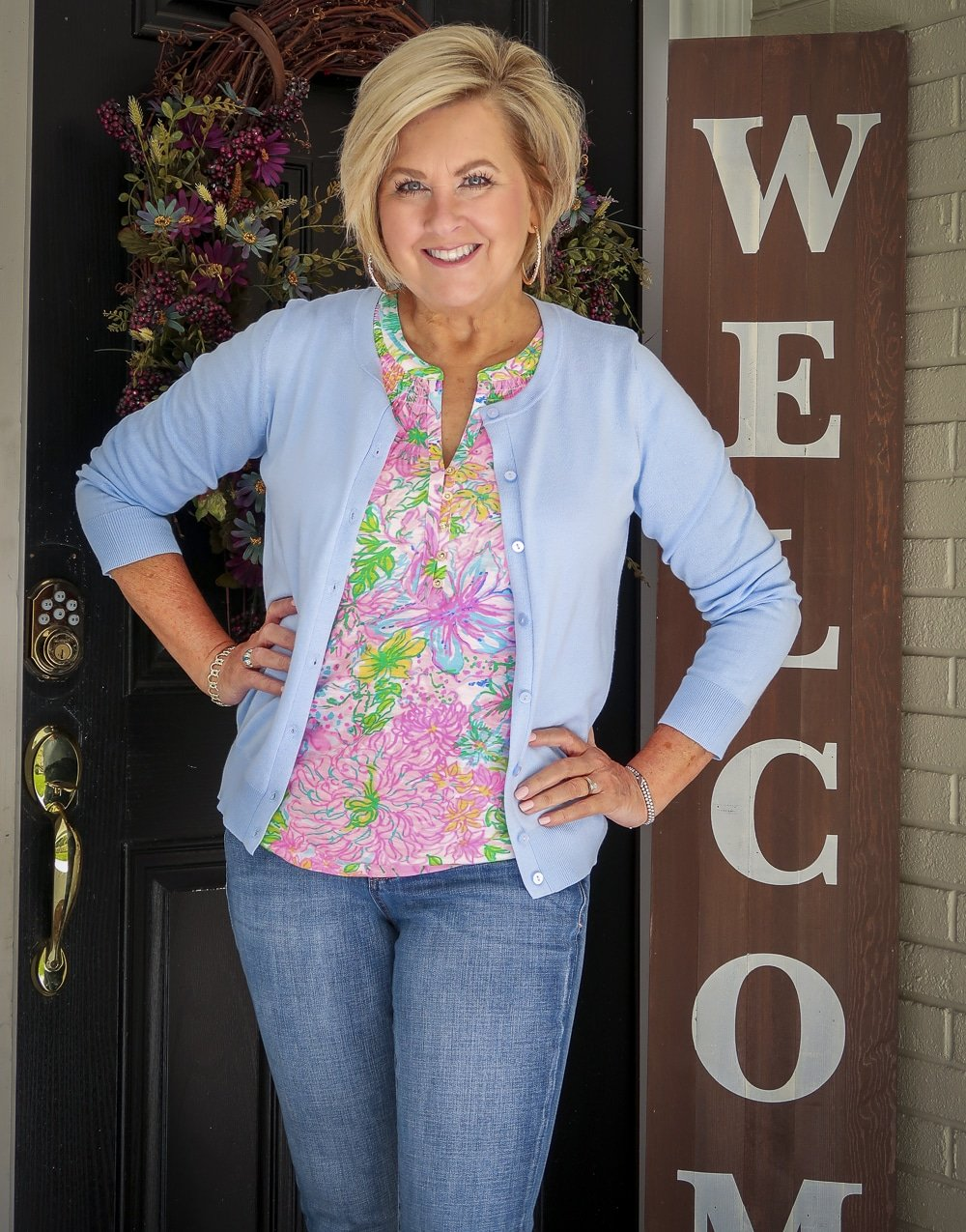 Fashion Blogger 50 Is Not Old is wearing a blue cardigan and a Lilly Pulitzer top