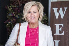 Fashion Blogger 50 Is Not Old wearing a hot pink t-shirt and a cream linen blazer
