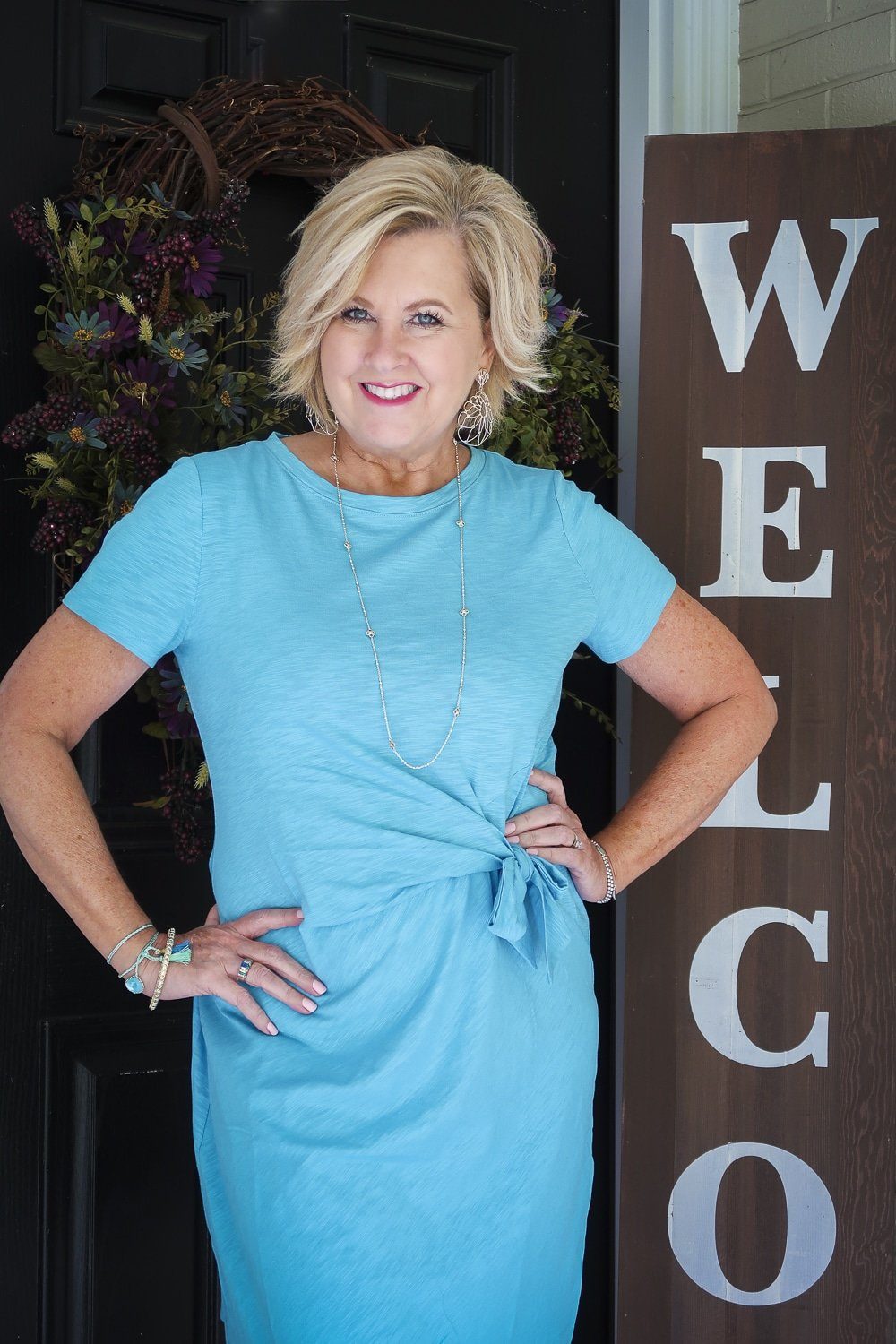 Fashion Blogger Tania Stephens is wearing a blue side-tie dress