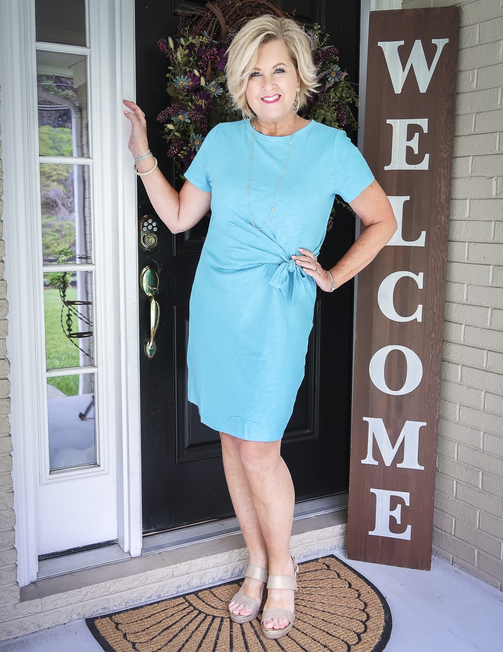 Fashion Blogger Tania Stephens is wearing a gorgeous blue side-tie dress and a pair of gold metallic espadrille sandals