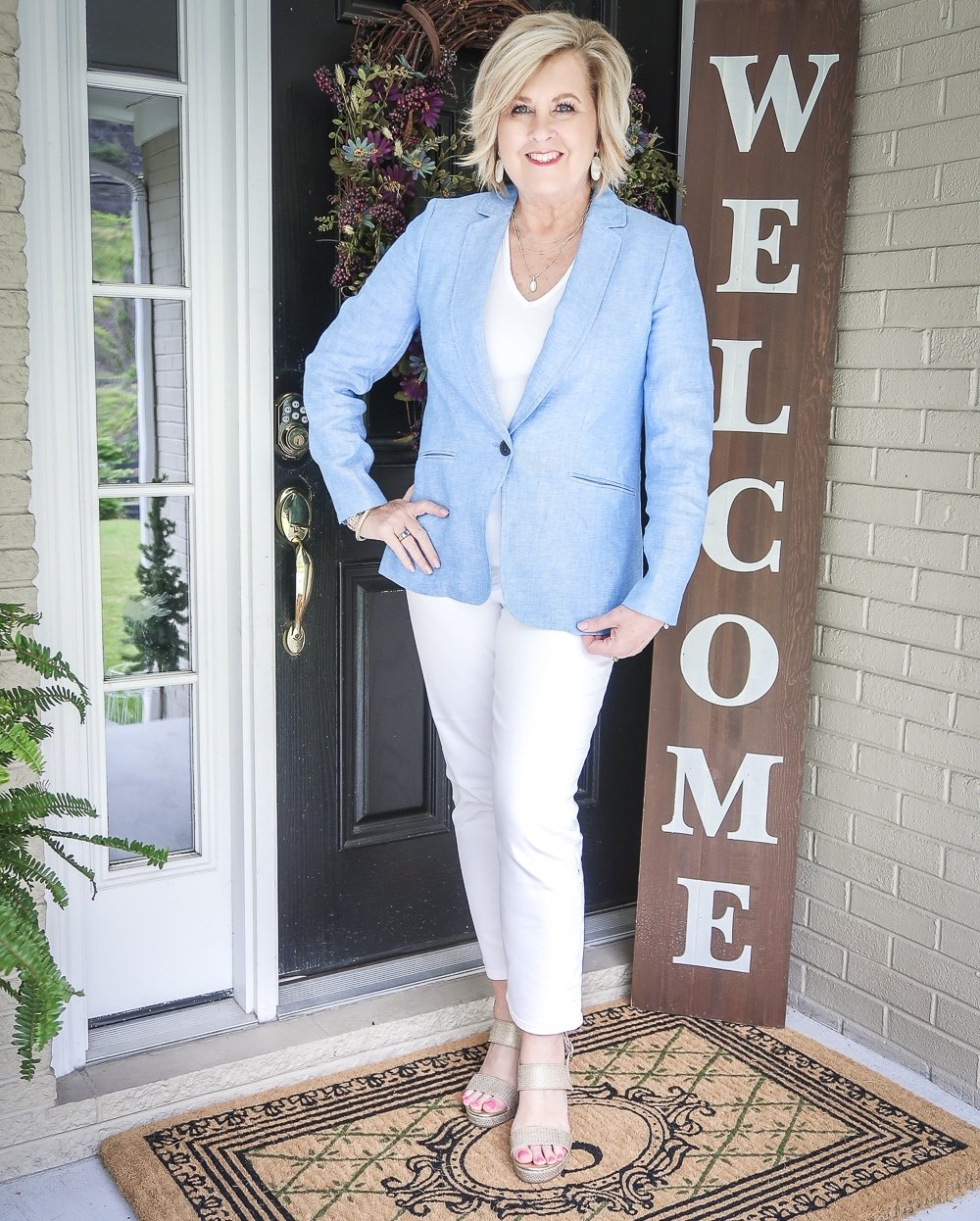 Fashion Blogger 50 Is Not Old is wearing an all white outfit with a blue linen blazer and gold espadrilles from Walmart