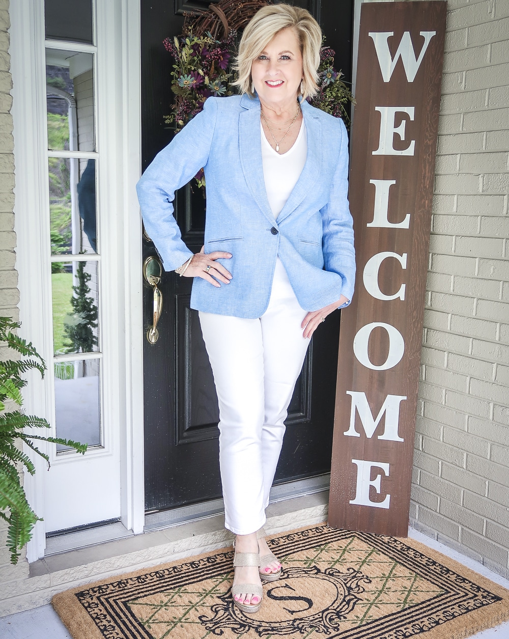Fashion Blogger 50 Is Not Old is wearing a white outfit with a blue linen blazer from Talbots and gold espadrilles from Walmart