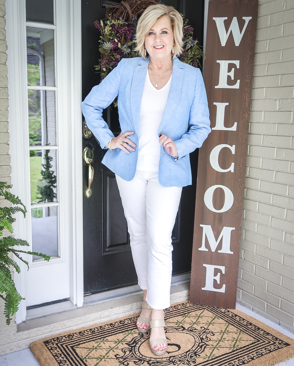 Fashion Blogger 50 Is Not Old is wearing an all white outfit with a blue linen blazer from Talbots and gold espadrilles