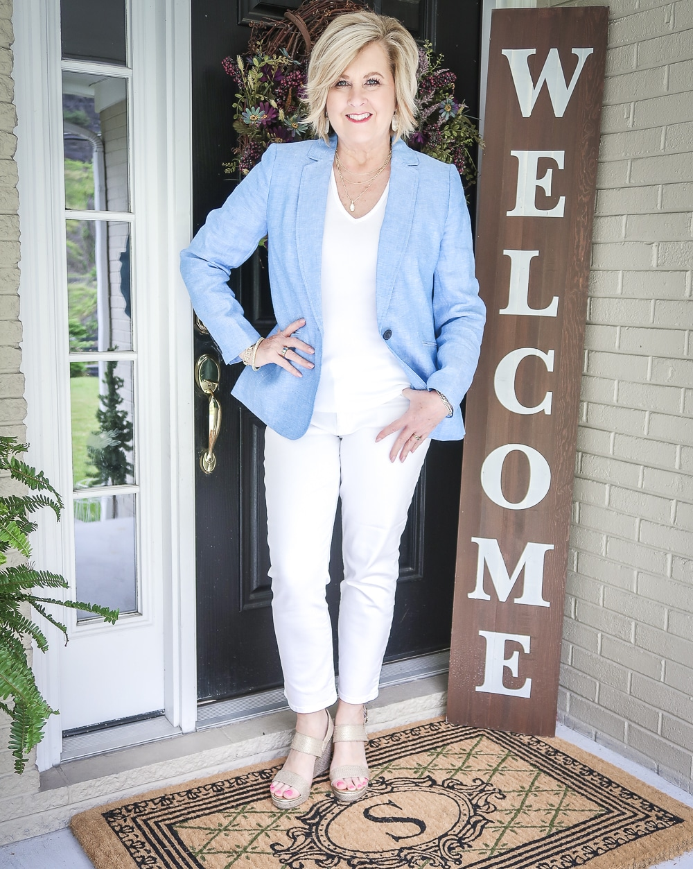 Fashion Blogger 50 Is Not Old is wearing an all white outfit with a blue linen blazer from Talbots and gold espadrilles from Walmart
