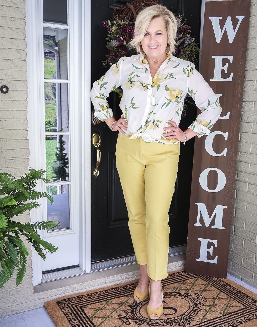 Fashion Blogger 50 Is Not Old is looking sunny in this white and yellow shirt and yellow pants, and a pair of yellow espadrilles from Michael Kors