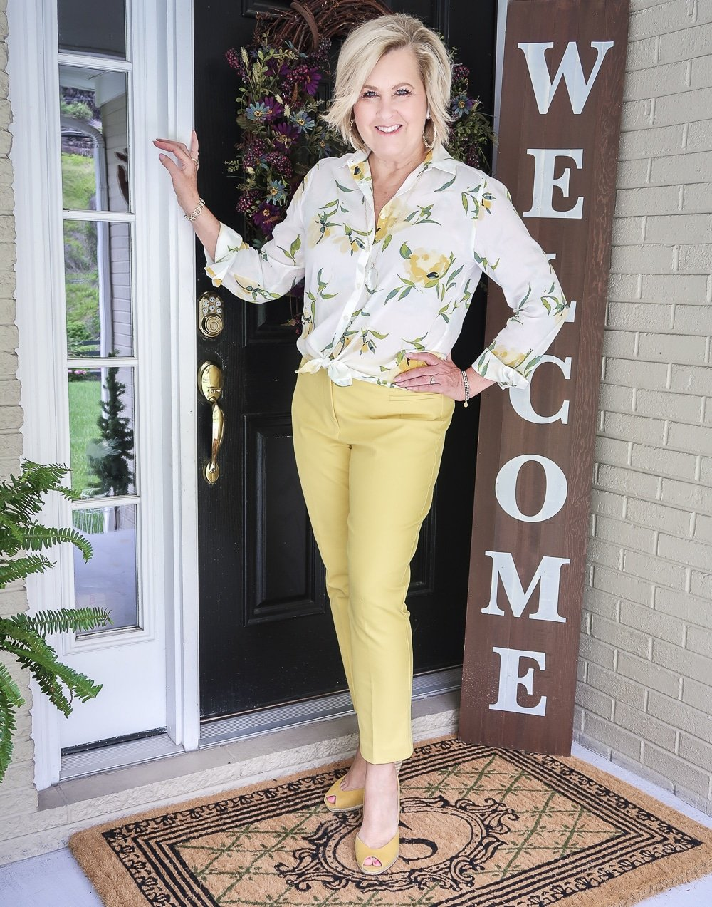Fashion Blogger 50 Is Not Old is looking sunny in this white and yellow shirt and yellow ankle pants, and a pair of yellow shoes from Michael Kors