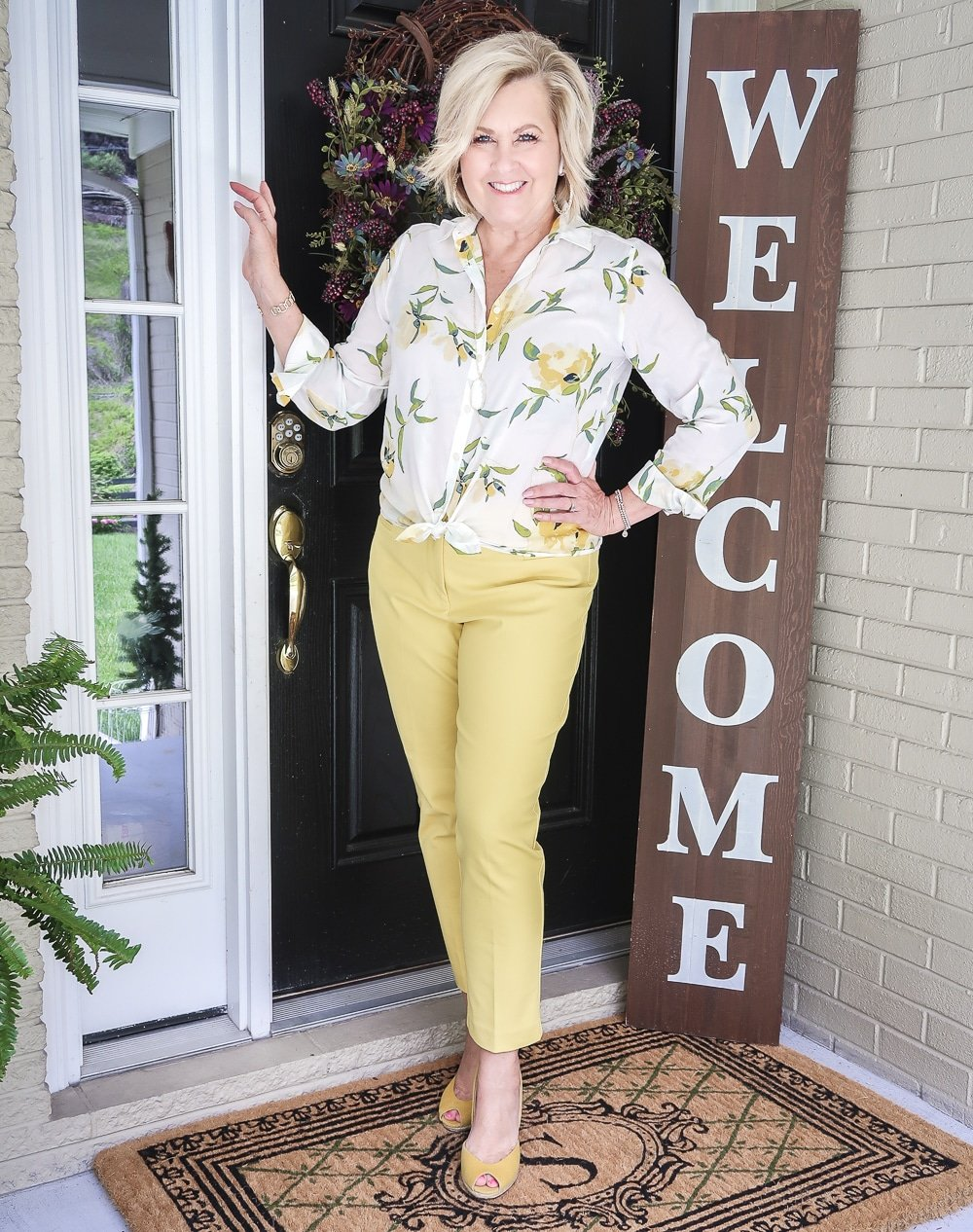 Fashion Blogger 50 Is Not Old is looking sunny in this white and yellow shirt and yellow ankle pants, and a pair of yellow espadrilles from Michael Kors