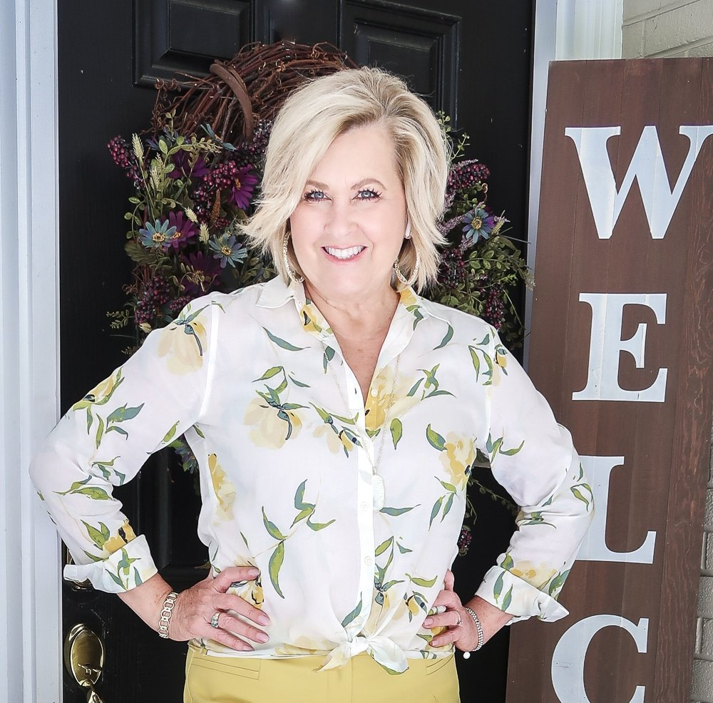 Fashion Blogger 50 Is Not Old is looking sunny in this white and yellow shirt tied at the waist