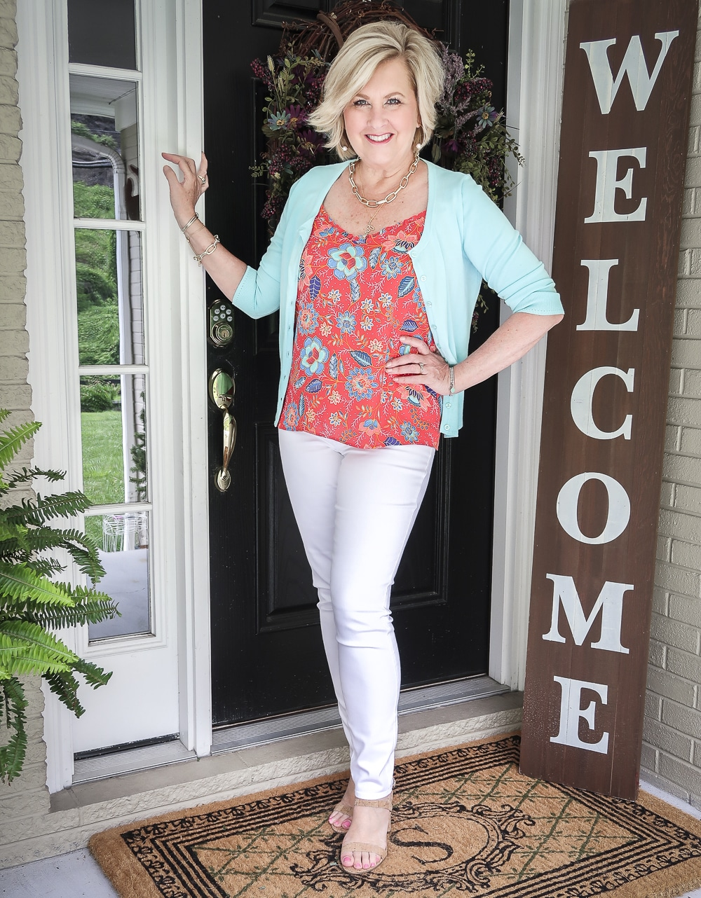Fashion Blogger 50 Is Not Old is wearing a red ruffled cami with white jeggings and a light turquoise cardigan