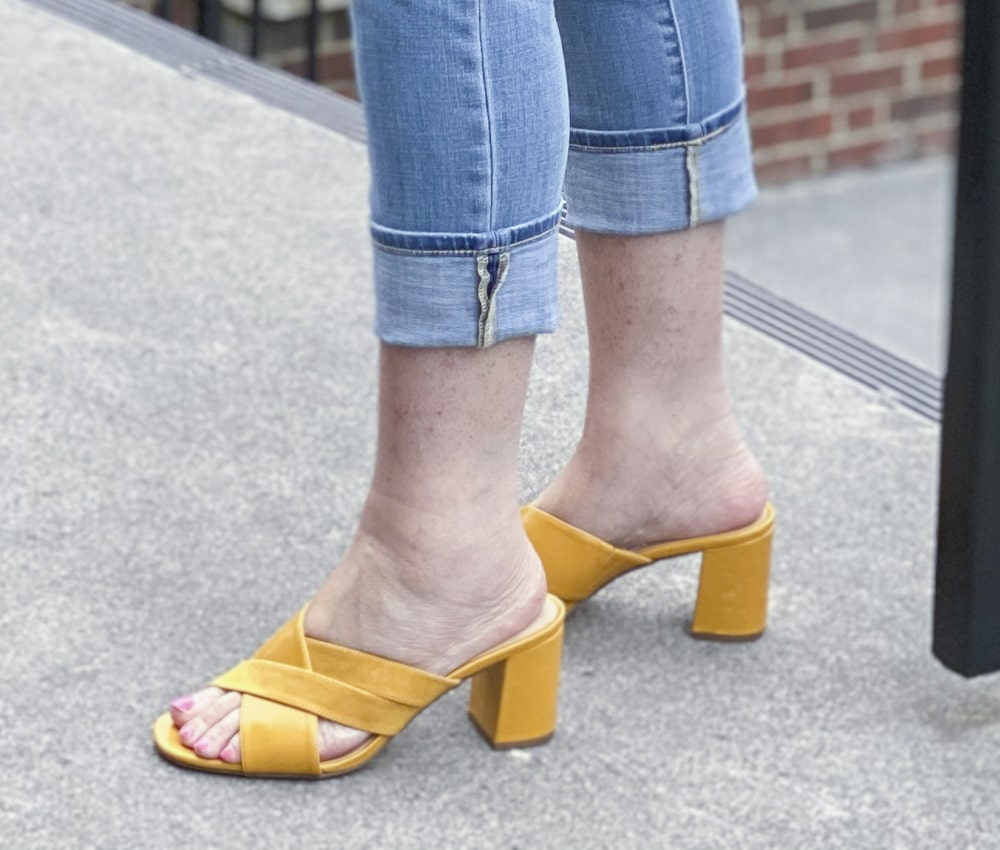 Fashion Blogger 50 Is Not Old is wearing mustard yellow block heel sandals