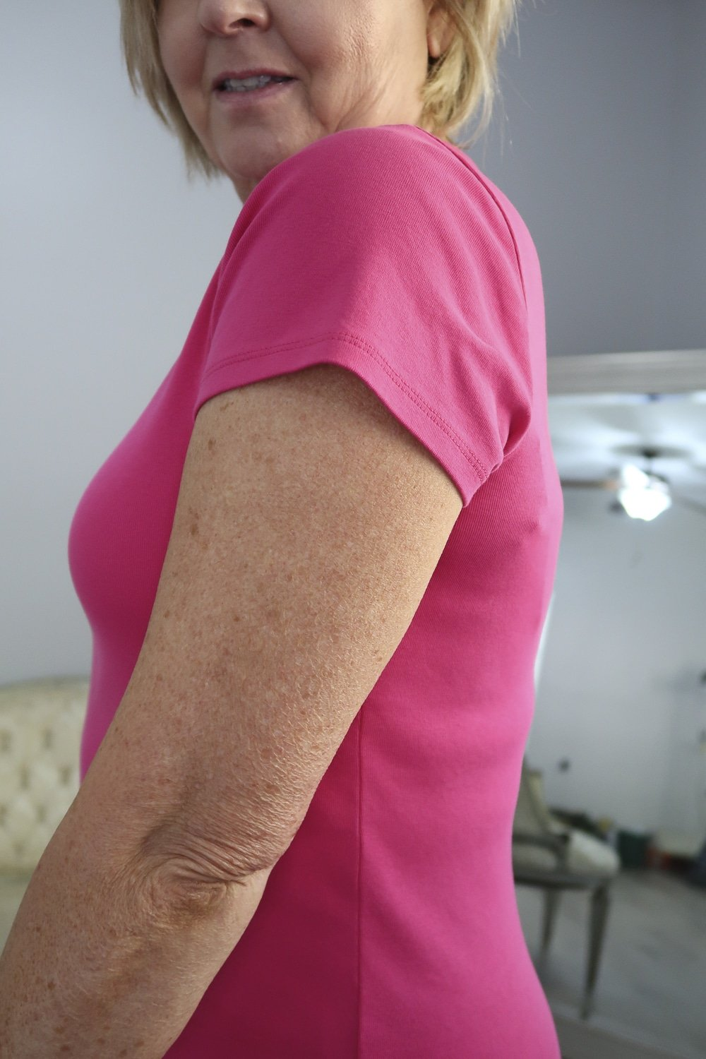 Fashion Blogger 50 Is Not Old wearing a pink t-shirt with a side view to help you choose the best bra