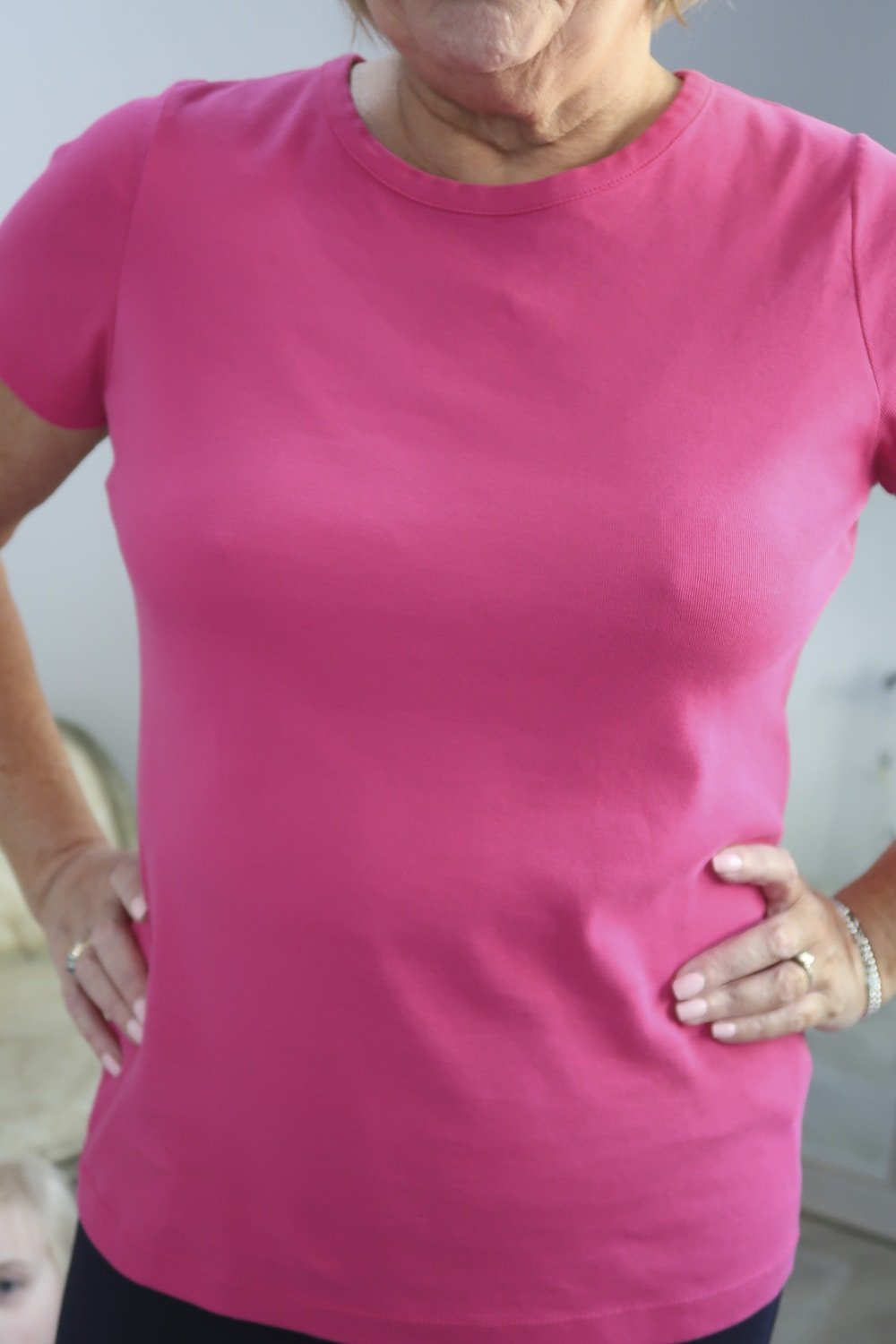 Fashion Blogger 50 Is Not Old styling a pink tee with a crew neck