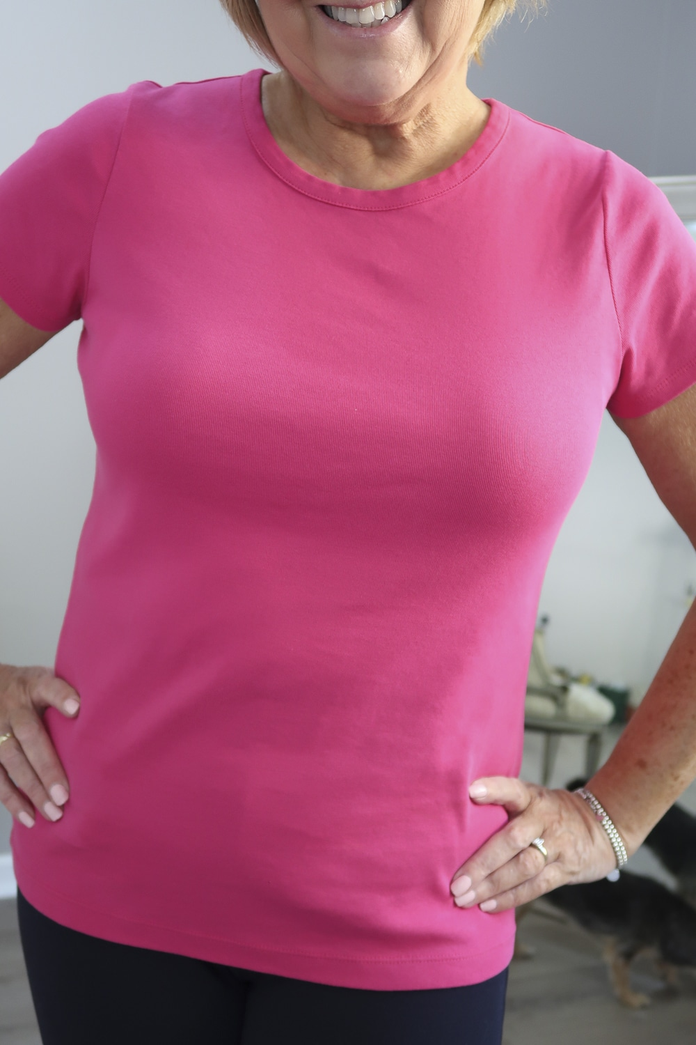 Fashion Blogger 50 Is Not Old styling a pink tee with a crew neck to help you choose the best bra