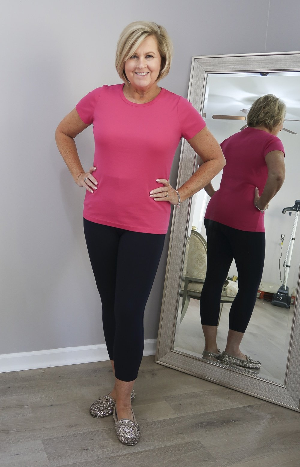 Fashion Blogger 50 Is Not Old styling a pink t-shirt with a crew neck with leggings to help you choose the best bra