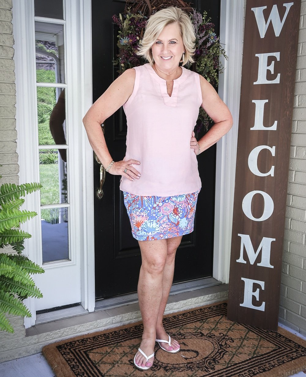 Fashion Blogger 50 Is Not Old is wearing a pale linen v neck top and a colorful skort