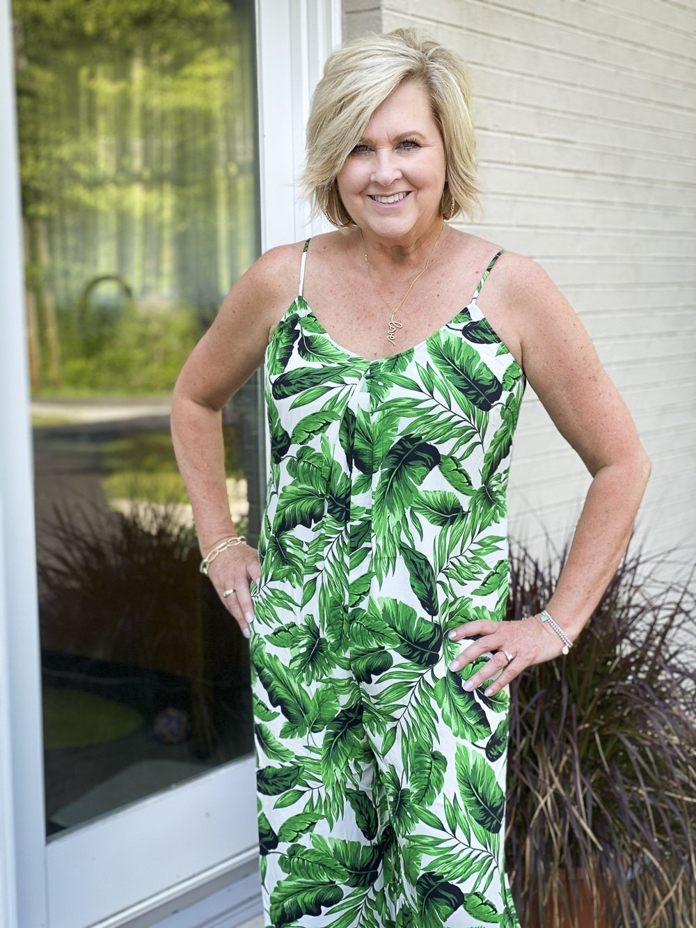 Fashion Blogger 50 Is Not Old is wearing a tropical banana leaf print jumpsuit from Walmart